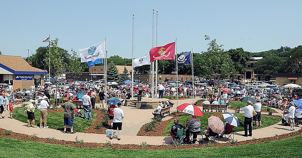 John Cross<br /> Despite the heat and humidity, a crowd of several hundred attended the dedication of the Veterans Memorial Place, Wednesday.
