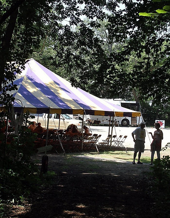 The main tent at the Waseca Chautauqua appears at the end of one of Maplewood Park's trails Saturday.
