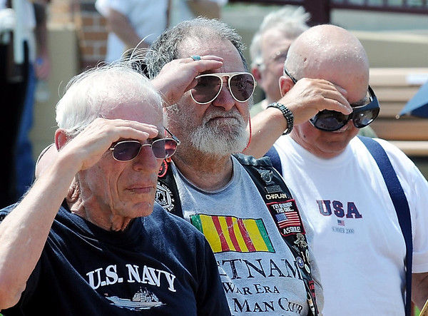 John Cross<br /> Veterans salute as flags are raised during the dedication of the Veterans Memorial Place, Wednesday.