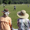 A pair of spectators watch the Arlington Greys take on the Mankato Baltics during Saturday's vintage baseball tournament at Land of Memories Park.