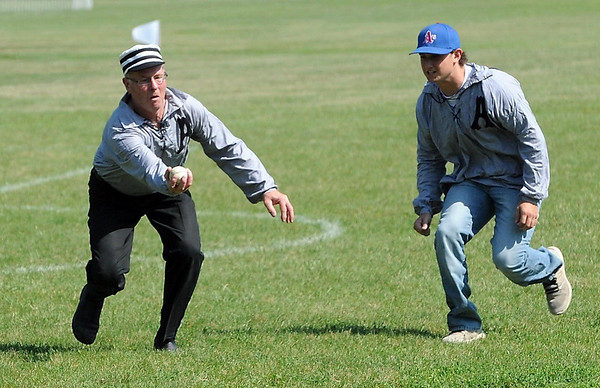 "Arlington Greys shortstop Matt ""Chief"" Pichelmann watches as third baseman Tim ""Pillowcase"" Kloeckl makes a catch during their match against the Mankato Baltics during a vintage baseball tournament Saturday."