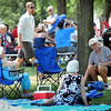 John Cross<br /> Peope attending St. Peter's Old Fashioned Fourth of July picnic in the shade at Minnesota Square Park, Wednesday.