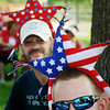 John Cross<br /> Randy Albright of Cleveland (front) and Chris Orchard of Mankato got into the spirit of the day Thursday by donning headgear with a patriotic theme while watching the parade  at St. Peter's Old Fashioned Fourth of July Celebration.