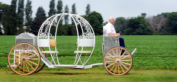 John Cross<br /> Arnie Lillo's horseless Cinderella carriage moves along at a stately 10mph.