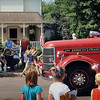 John Cross<br /> Youngsters scramble for candy tossed from a vintage fire truck along the parade route of St. Peter's Old Fashioned Fourth of July Celebration on Thursday.