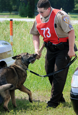 John Cross<br /> Police work done, Duke, a 2 1/2-year-old German Shepherd and his handler, Sgt. R.S. Berg of the Chisago County Sheriff's Department engage in a tug-of-war, a reward for the dog successfully locating items during an article search event at the USPC Region 12 Field Trials Monday at St. Peter.