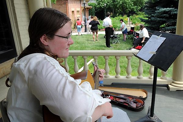 John Cross<br /> Brooklyn Youngerberg provided some guitar music for picnickers attending an Independence Day Celebration at the historic R.D. Hubbard House on Saturday.