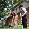 John Cross<br /> Hank Heyer (left) and Zeke Bartlett were dressed in turn-of-the-century clothes as they played a game of croquet outside of the carriage house during an Independence Day Celebration Saturday at the historic R.D. Hubbard House.