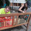 Avery Lawton (right), 11, and Jeremy Wiesen paint a bench that will be used by the homeless community who come to Holy Ground at Centenary United Methodist. Photo by Jackson Forderer