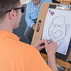Casey Christenson draws Vincent Kelly at a Greater Mankato Growth event in early June. Photo by Jackson Forderer