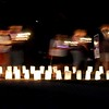 Walkers with candles take a silent lap among the luminaries at the Blue Earth County Relay For Life Friday at Ray Erlandson Park.