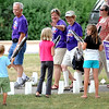 Cancer survivors wave to children as they cheer during the survivor lap at Friday's Relay For Life at Ray Erlandson Park.