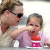 Vicki Zernechel tries to persuade her grand daughter Ava Marie, 4, to give her a bite of a sno cone Saturday at the Waseca County Fair.