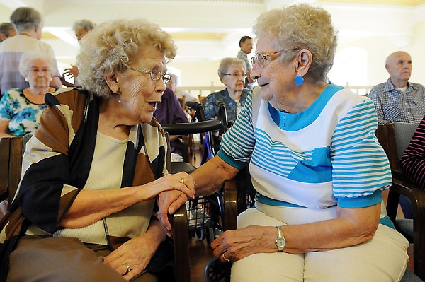 John Cross<br /> Gladys Olson (left), one of the first investors in, and original resident of, Old Main Village, visits with friend Janet Kiehm during a 25th anniversary celebration of the former college building.
