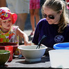 John Cross<br /> Minnesota State University student Brianna Pagel plays with her cousin, Navaeh Pagel, at a fifth annual Play Day at Rasmussen Woods on Friday.