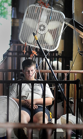 John Cross<br /> Simon Sommers of Janesville gained some relief from Thursday's stteamy heat from the fans he was using to keep his sheep comfortable in the sheep barn at the Waseca County Fair. The fair continues through Sunday.