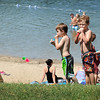 Pat Christman<br /> Jackson Bennett, 6, and Alex Fritz, 6, enjoy a popscicle on a warm day on a break from swimming at Hiniker Pond.
