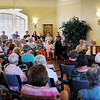 John Cross<br /> Local developer Curt Fisher gives people attending a 25th anniversary of Old Main Village a history of how the former college building was transformed to a residence for seniors.