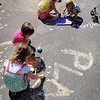 John Cross<br /> The Rasmussen Woods parking lot was an artist's canvas for children participating on Friday in a Play Day sponsored by students in MSU's early childhood development program.
