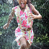 John Cross<br /> Ayanna Montaque sprints through a sprinkler during a summer playground program at North Mankato's Wheeler Park on Tuesday. More heat and tropical humidity are predicted for today.