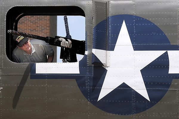John Cross<br /> A visitor to the Wings of Freedom Tour checks out a machine gun on a B-24 Liberator at the Mankato Regional Airport on Monday.