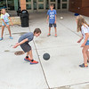 From left, Carlie Wenginger, 10, Evan Oachs, 11, Brendan Isenberg, 11, and Alissa Betz, 10, play four square outside of Prairie Winds Middle School during Connections camp. Photo by Jackson Forderer