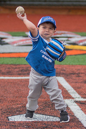 Jalen Day, 2, plays catch before the start of the LEEP softball game played at Franklin Rogers Park on Thursday. Proceeds from the charity softball game fund ongoing LEEP programming. Photo by Jackson Forderer