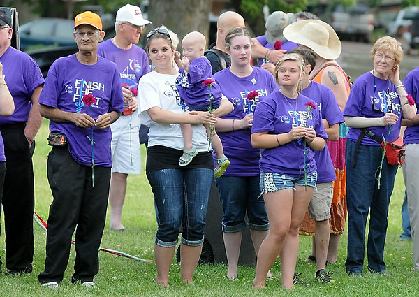 Leukemia survivor Madison Brockberg, 3, dances in the arms of her mother Jessica during the Blue Earth County Relay for Life Friday at Ray Erlandson Park. Photo by Pat Christman