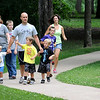 Visitors to Minneopa State Park stroll down a trail leading to the falls area this past weekend. One of the outreach programs funded by the the 2008 Legacy Amendment targeted families with school-aged children.  Photo by John Cross