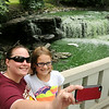 Lindsey Michael of St. Peter (left), and Esme Bradach of Monticello, pose for a selfie below the upper falls at Minneopa State Park this weekend. Visitor numbers are up in Minnesota State Parks and the DNR says it is the result of outreach programs made possible by the 2008 Clean Water, Land and Legacy Amendment sales tax increase. Photo by John Cross