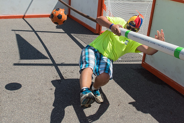 Garrett Burgess maintains his grip on his human foosball rail after making a kick save while playing goalie for the I+S Group Foos Your Daddy on Saturday. Photo by Jackson Forderer