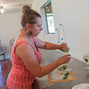 Emily Knudsen creates a drink using basil leaves in the kitchen at the Pleasant Grove Pizza Farm in rural Waseca. Knudsen and her partner Bill Bartz will be hosting the second annual Mini Music and Art Fest at the farm on July 29 from 11:30 a.m. to 10:30 p.m. Photo by Jackson Forderer