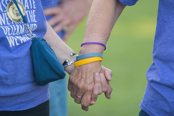 Phyllis Richter (right) and Helen Jaeb hold hands as they waited to be introduced as cancer survivors at the Relay 4 Life on Friday. This is the 22nd year the event has been held in Mankato. Photo by Jackson Forderer