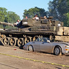 "A Mark-10 Chieftain crushes a car as part of Wargaming.net's ""Let's Battle Tour"" at Drive A Tank in Kasota on Saturday. Photo by Trey Mewes"