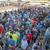 """Attendees of the """"Let's Battle Tour"""" wait outside of Drive a Tank in Kasota on Saturday. It was estimated that 1,600 people attended the event that featured the """"War of Tank"""" game and tank rides. Photo by Jackson Forderer"""