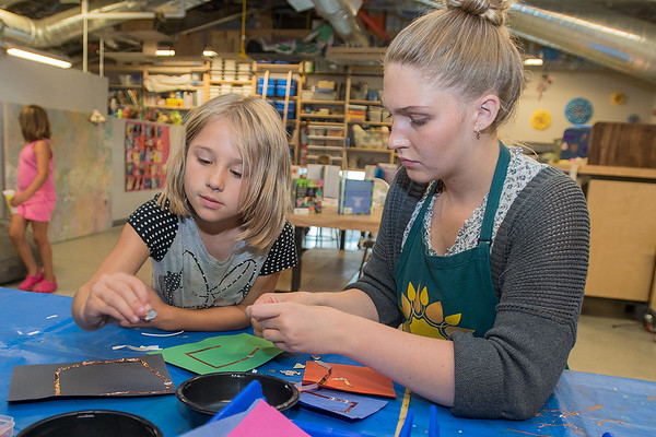 Elena Gottlick (right) helps Miranda Kral (6) make a circuit at the loft of the Children's Museum of Southern Minnesota. Different activities are focused around the theme of electricity this week at the loft. Photo by Jackson Forderer
