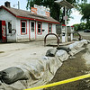 O'Leary's, a longtime fixture in Waterville remains closed and surrounded by sandbags after water from the nearby Cannon River and Lake Tetonka receded. In spite of the sandbagging, the business was flooded with nearly two feet of water. Photo by John Cross