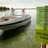 It was going to be a slow ride in a big boat for boaters launching their craft on East Lake Jefferson where a no-wake policy was in effect because of high water. All lakes in Le Sueur County and all but three lakes in Blue Earth County had no wake restrictions in effect over the Fourth of July. Photo by John Cross