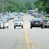Parked cars lining busy Highway 60 attest to the popularity of the small communities Fourth of July celebration. Photo by John Cross