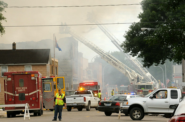 Fire fighting equipment clogs the business district of Waterville to battle a Thursday morning fire. Photo by John Cross