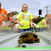A racing turtle sprints for the finish line during turtle races at Elysian's Fourth of July celebration. Photo by John Cross