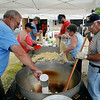 Volunteers for the Mankato Chapter 10 of the Disabled American Veterans pop and bag kettle corn on Tuesday near the Morson Ario. The volunteers popped more than 800 bags of the treat to be sold during St. Peter's Old Fashioned Fourth of July Parage on Friday to raise funds for the DAV. Photo by John Cross