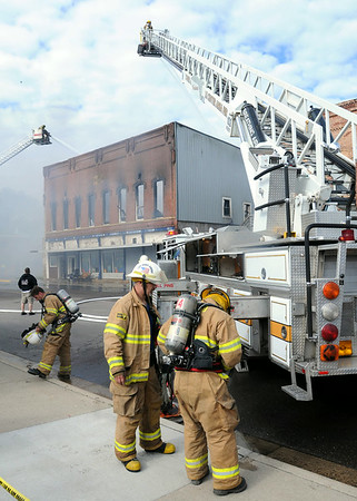 Firefighters battle a fire in the Rogers Building in downtown Waterville on Thursday. Photo by John Cross
