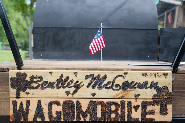"A sign made by Vusa Bentley on a mobile wagon that includes a brick oven for pizzas built by Bentley and Jack McGowan. Bentley said they built the pizza oven for a good cause and ""to make a difference in someone's life in Mankato."" Photo by Jackson Forderer"