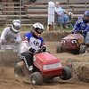 John Cross<br /> Lawmower racers bounce around a corner during a heat race at the Blue Earth County Fair on Saturday.