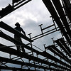 John Cross<br /> A worker erects bleachers along side the practice fields at Minnesota State University Monday in preparation for the beginning of the Minnesota Vikings pre-season training camp. Players will arrive Thursday and practices will begin on Friday.