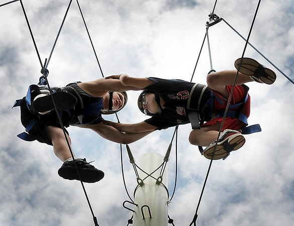 John Cross<br /> Kyle Sonnek (left) and Kawika Hashimoto have to rely on teamwork 35-feet in the air as they traverse the High-V, one of the stations at the ropes course at Minnesota State University, Monday. They are participating in a YMCA Teen Adventure Camp this week that features a variety of activities including archery, paintball, and kayaking.