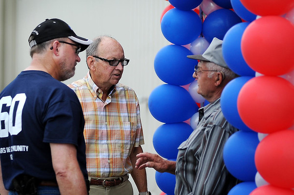 Lyle Jacobs, former owner and CEO of Katolight, talks with retired Katolight employee Richard Carda (right) and MTU Onsite Energy employee Keith Burg Friday during a 60th anniversary celebration.