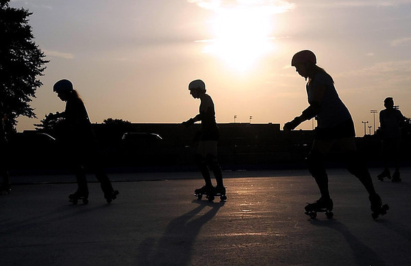 The Mankato Area Derby Girls practice on the outdoor hockey rink near Mankato East High School Tuesday evening.