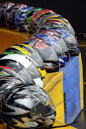 Crash helmets are lined up on a race track barrier for the running of the seventh annual MRCI Grand Prix fund raiser Saturday.